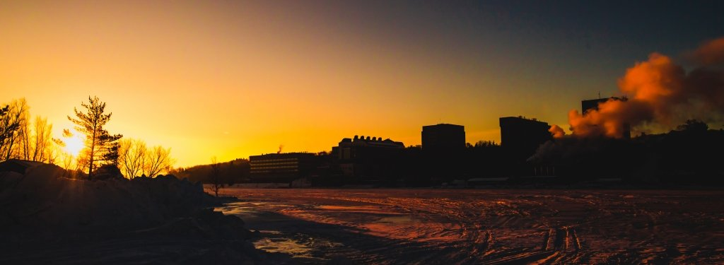 Sunrise over Michigan Tech campus in silouhette