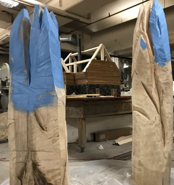 blue and white wooden stands that look like mountains in a basement work area