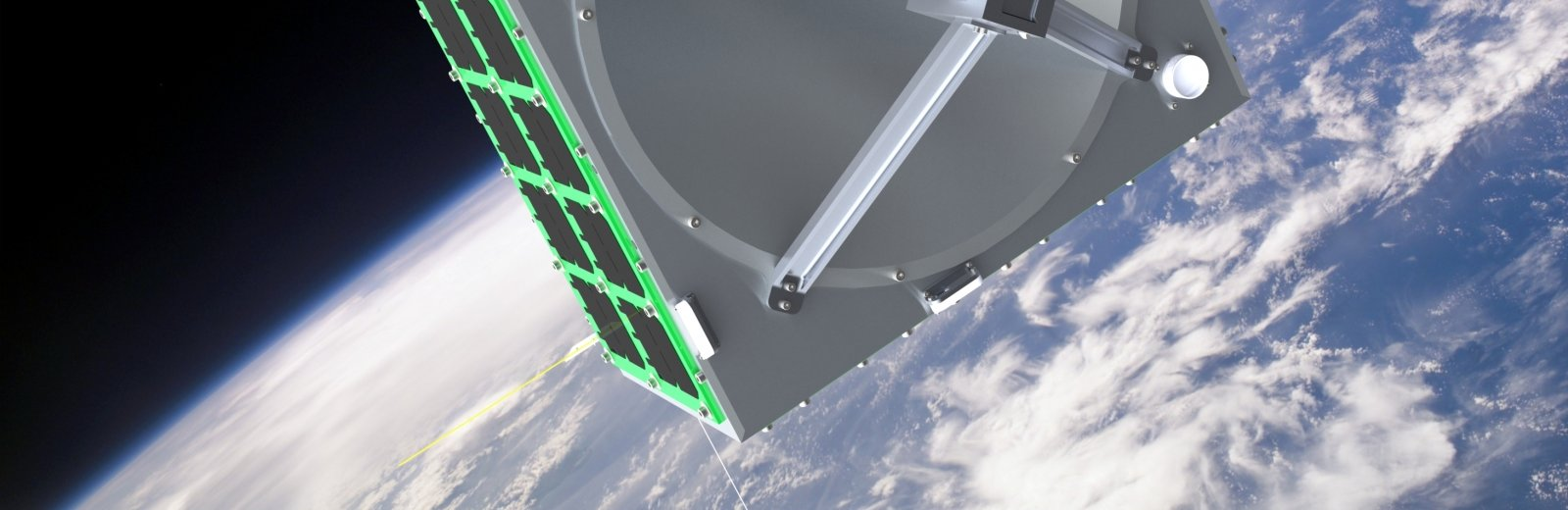 A rendering of a square satellite with small rectangular black panels on it with the earth and a black background