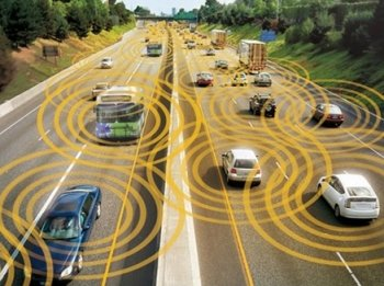 Cars drive on a divided highway and concentric circles show how connected traffic might interact.