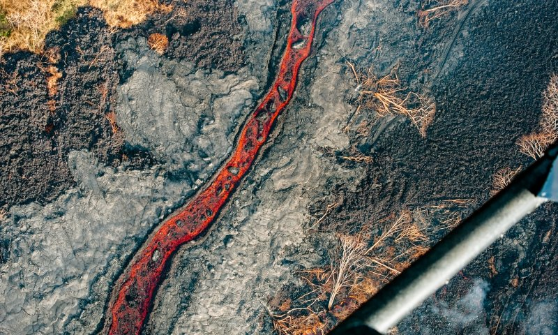 A river-like flow of red lava in Hawaii.