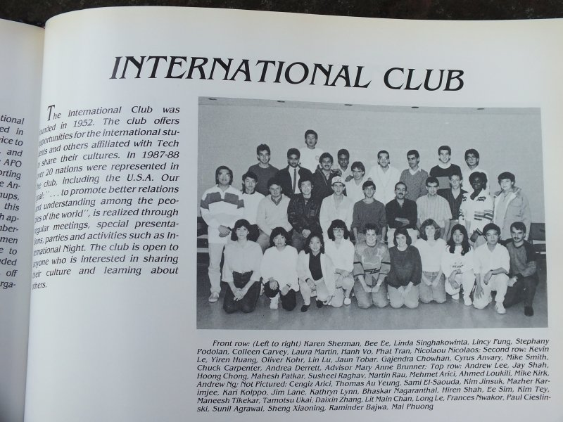 a black and white photo with the words International Club and 30 male and female students lined up in rows for a yearbook photo from 1988