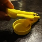 yellow plastic device with pill in its center