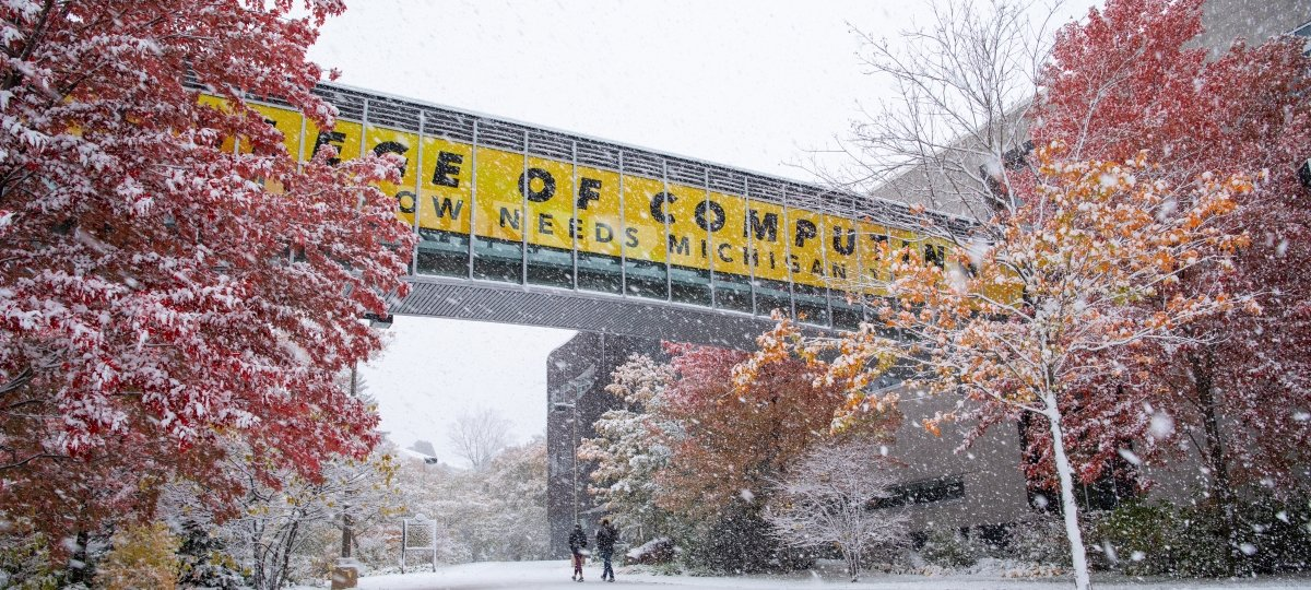 Michigan Tech sky bridge with fall color and first snow