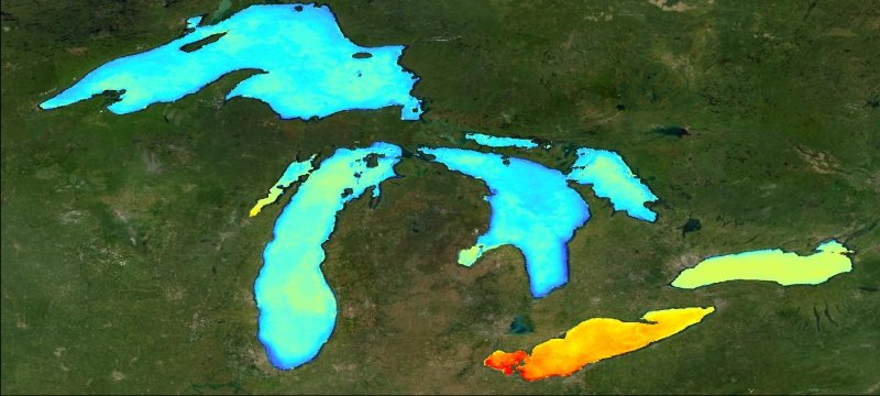 A satellite image of the Great Lakes with different colors across the lakes to show lake production values.