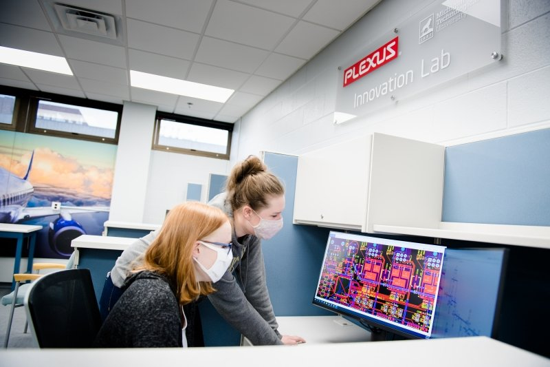 Two students working in the Plexus Innovation Lab