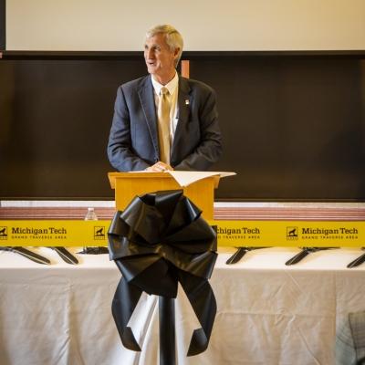Michigan Tech President Rick Koubek speaks at a podium.