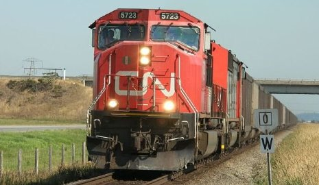 CN train traveling along the tracks.