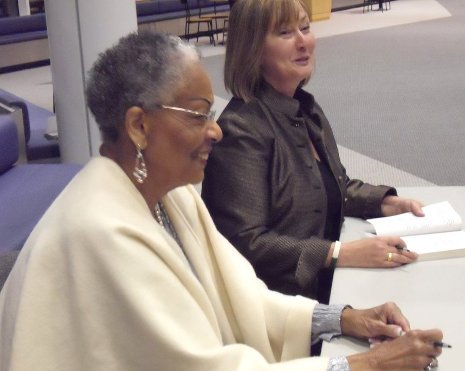 Evangeline Moore and Susan Carol McCarthy at booksigning in the Rozsa Center