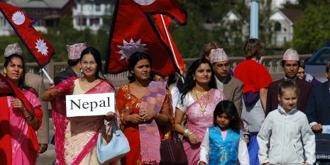 Community residents from Nepal showcase the traditional clothing of their homeland during a past Parade of Nations.