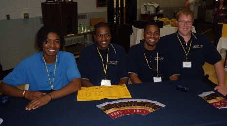 Alpha Kappa Psi, professional business fraternity, helped stage the Career Fair. From left: Jonathan  Clifton, Shandre Huff, Keshon Moorehead, and Tom Brindley.