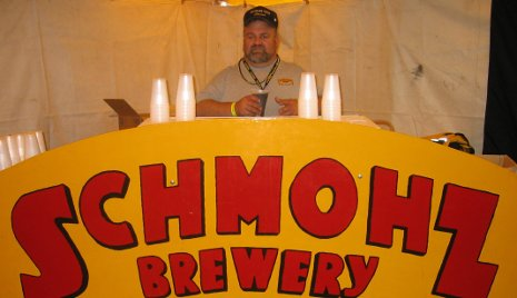 Chas Thompson of Schmohz Brewery at the alumni tailgate party in Grand Rapids.