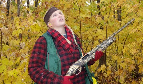 Graduate student Tara Bal prepares to shoot maples leaves down from the forest canopy