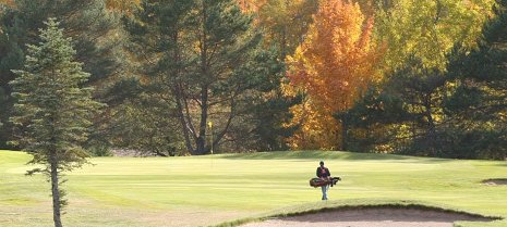 The last round: a lone golfer gets in his last round at Portage Lake Golf Course.