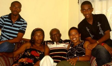 Fredline Ilorme (2nd from right), her parents and brothers in Haiti