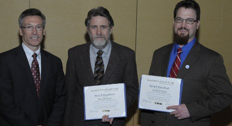 Terry McNinch, center, and Tim Colling (right) receive Transportation Research Board Charley Wootan Award from Robert Johns, chair, Technical Activities Council.   Photo: Transportation Research Board