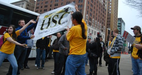 Michigan Tech students unfurl Undergraduate Student Government rally banner in Lansing.