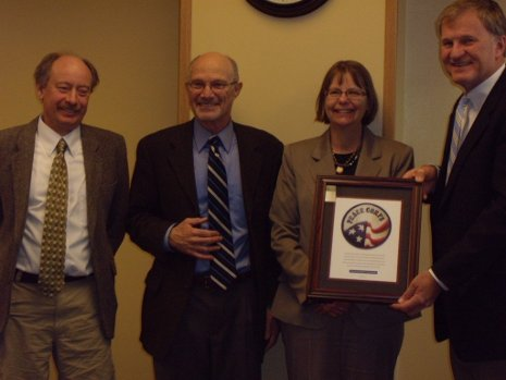 Peace Corps official Eric Goldman, visits Tech to recognize Michigan Tech's Master's International Programs. Pictured, left to right, are forestry professor Blair Orr, Goldman, Graduate Dean Jackie Huntoon, and President Glenn D. Mroz.