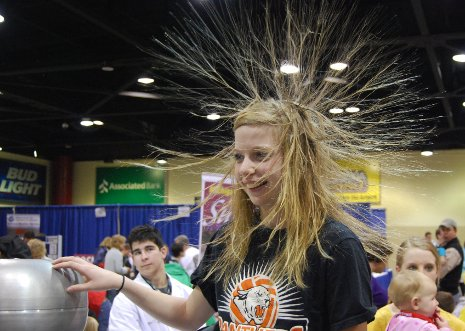 Touching a Van de Graaff generator makes your hair stand on end.