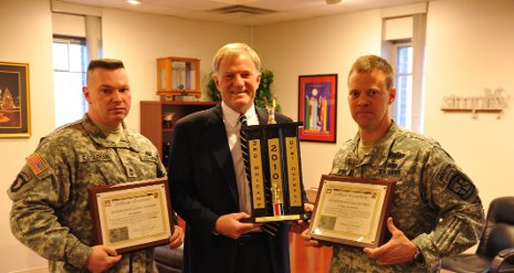 President Glenn Mroz (center) accepts awards for the ROTC Program from Master Sgt. James Eagleman (left) and Lt. Col. James Spence.