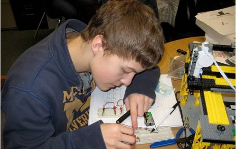 Chassell High School student Jared Jarvi working on the wiring of a
