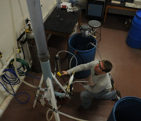 Chemical engineering grad student Brett Spigarelli and the CO2 scrubber he helped to design.