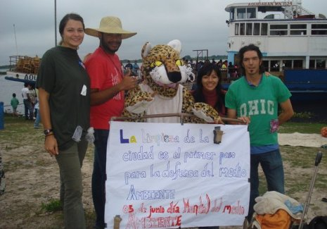 Peace Corps volunteer Michelle Cisz in Paraguay with local volunteers and their mascot, a jaguar used by the volunteers to get people interested in their community projects, like this street clean-up campaign.