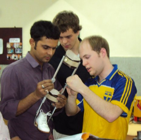 Bryan Plunger and an Indian colleague work on the leg-brace prototype