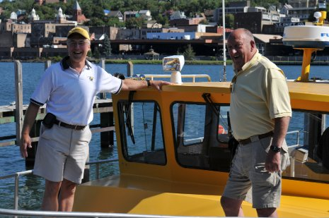 Bud Rieckhoff '60 and Mark Jarmus '80 tour the Keweenaw Waterway aboard Tech's research vessel, the Agassiz, during Reunion 2010.