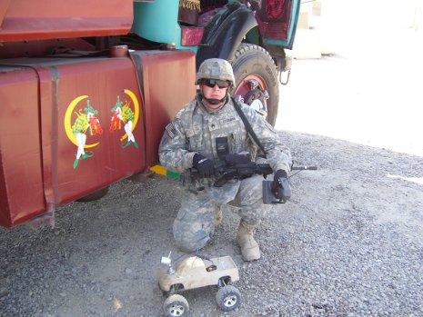 Staff Sgt. Chris Fessenden in Iraq with the radio-controlled truck his brother Ernie built to help him inspect vehicles