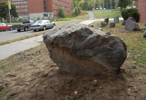 Rocks mark the spot where Michigan Tech's new Mining Boulder Garden is taking shape. The three-ton Sudbury boulder is in the foreground. Dennis Walikainen photo