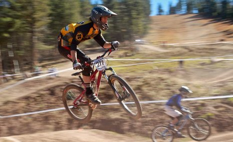 Paul Mayes in the USA Cycling Collegiate Mountain Bike Championships Division II dual slalom semifinals against Air Force's Scott Hoenisch in the background. Johnathan Devich, USA Cycling photo