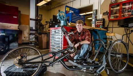 James Cook, a senior in mechanical engineering, works on The Tomahawk, one of two hand-cranked cycles that Senior Capstone Design teams built for wounded veterans who ride for the Achilles Freedom Team.