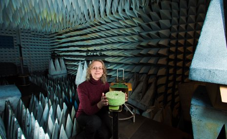 Elena Semouchkina tests ceramic resonators in the anechoic chamber in her lab.
