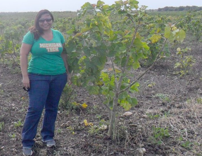 Mayra Sanchez Gonzalez is shown with a Jatropha plant, which is used for biofuel in her native Yucatan, Mexico.