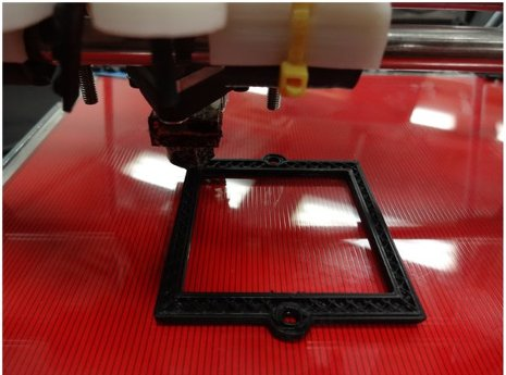 An open-source 3D printer printing an optical component, specifically, a filter bracket.