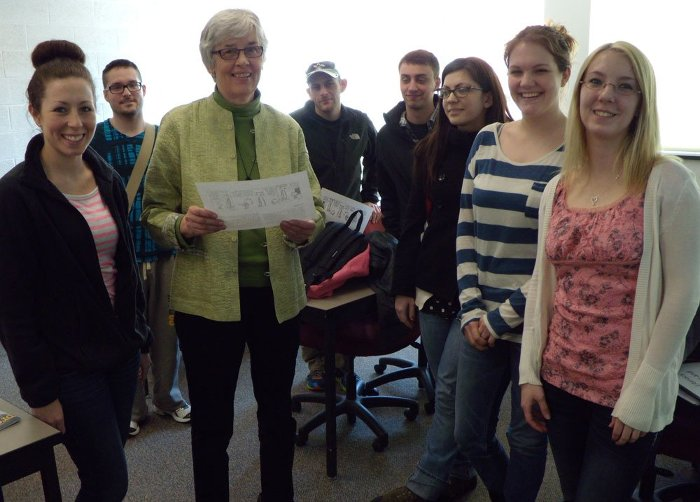 Beth Flynn and her last class gather, with Calvin and Hobbes.