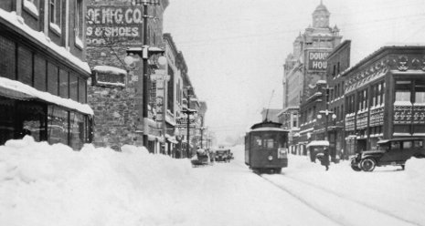 A streetcar travels a snowy Shelden Ave. in downtown Houghton. <br><br> Photos reprinted with permission from Copper Country Streetcars by William J. Sproule. Book available from the publisher online at www.arcadiapublishing.com or 888-313-2665