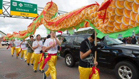 Chinese students weave their traditional dragon through the crowd at the Parade of Nations.