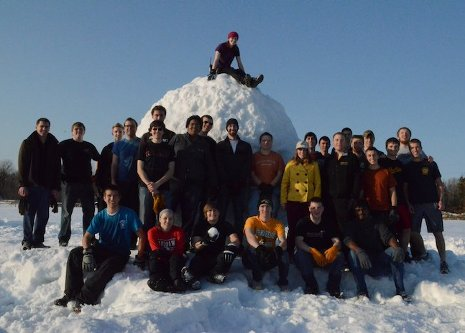 Michigan Tech students gather around the Guinness World Record snowball they created last spring.