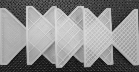 3D printing can save energy by using less raw material. These partially printed Swiss children's blocks show how a printer can partly fill the interior of an item with plastic while maintaining its strength. Samuel Bernier photo