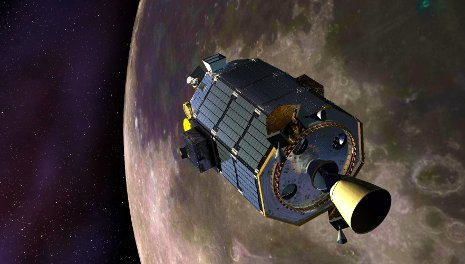 An artist's concept showing the Lunar Atmosphere and Dust Environment Explorer (LADEE) spacecraft is seen orbiting the moon as it prepares to fire its maneuvering thrusters to maintain a safe orbital altitude. Credit: NASA Ames / Dana Berry