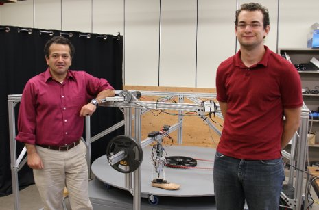 Assistant Professor Mo Rastgaar and PhD student Evandro Ficanha with their new computer-driven foot. The ankle can mimic a natural walk, allowing the foot to walk in circles on the circular treadmill, shown. Emil Groth photo