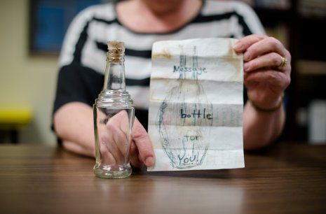 Nancy Auer with the bottle set loose by a Minnesota family near Thunder Bay. It found its way to her home near Eagle River.