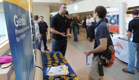 Students talk with representatives from Gerdau, a major steel industry company.