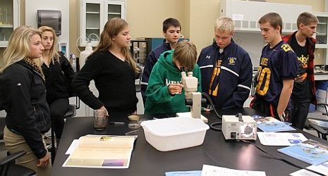 High school students analyze water samples they collected while out on the Agassiz, Michigan Tech's research vessel.