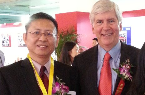 "Xiaodi ""Scott"" Huang in China with Michigan Governor Rick Snyder."