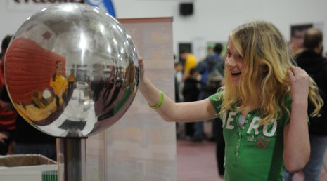 Touching a Van de Graaff generator makes your hair stand on end - literally.