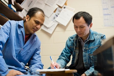 PhD candidate Durga Pokharel, left, and his advisor, chemist Shiyue Fang, working out solutions to challenges in their research on purifying DNA and peptide molecules. Sarah Bird photo