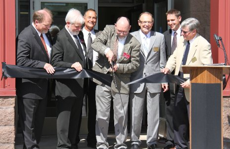 Cutting the ribbon at the new physical therapy doctoral program facilities at the ATDC. From the left, Chris Ingersoll, Michael Gealt, Herm Treizenberg, Peter Loubert, Max Seel, Jason Carter and Bruce Seely.